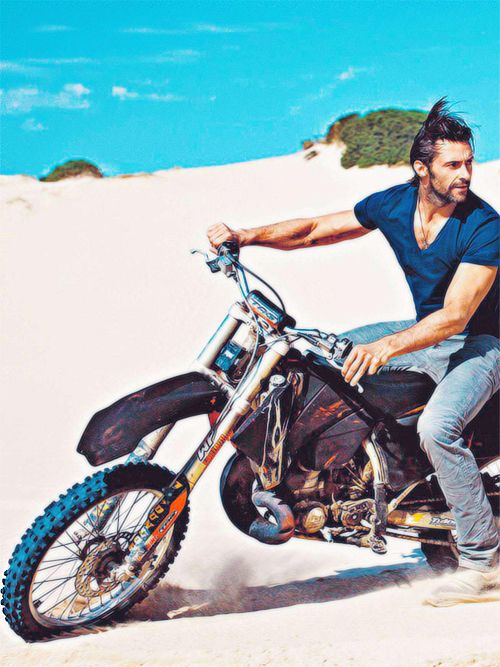 hugh jackman on a bike, can't get any more perfect than that