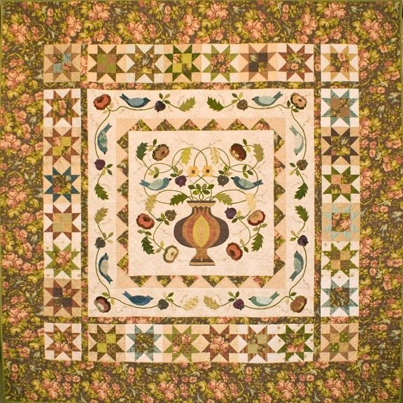 Barbara Brackman's MATERIAL CULTURE: Morris Flowerpot Design - Floral fabric appears in center of sawtooth stars and in sashing so pieced and applique elements seem to float on background.