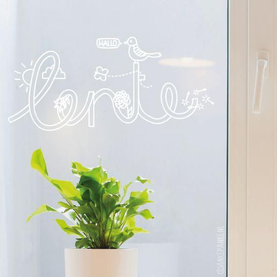 Hallo lente typografische raamtekening met vogel, vlinder, bloem en zonnetje. Dat maakt toch iedereen vrolijk?
