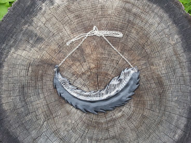Black and silver polymer necklace in the shape of a feather.  Inspired by leather raven feather necklace on Etsy.