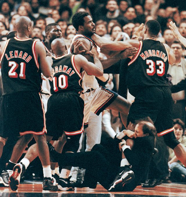 Today is the 50th birthday of Jeff Van Gundy. Theformer Knicks and Rockets coach may be best remembered for his role in the famous Knicks-Heat brawl of May 1998. As Charles Oakley and Alonzo Mourning squared off, Van Gundy famously grabbed ontoMourning's leg to prevent the fight. Van Gundy is now an analyst for ESPN's coverage of the NBA. (Jeff Christensen/Reuters)  SI VAULT: Van Gundy is easy to mock, but he's shrewd and fearless (10.30.00)