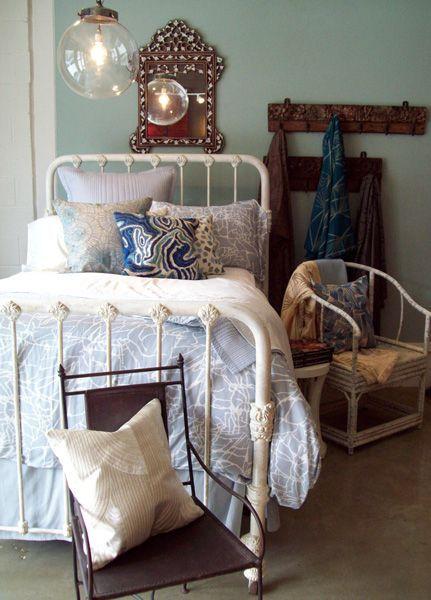 iron bed with spring bedding via dwellingsanddecor.tumblr.com