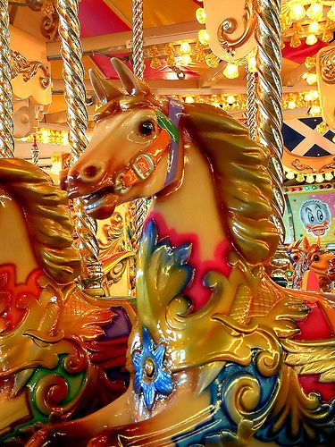 Carousel Horse: The Merry-Go-Round was my favorite ride as a child. I would always look for a black horse and my daddy would always lift me up and set me on top. Wonderful memories! :-)