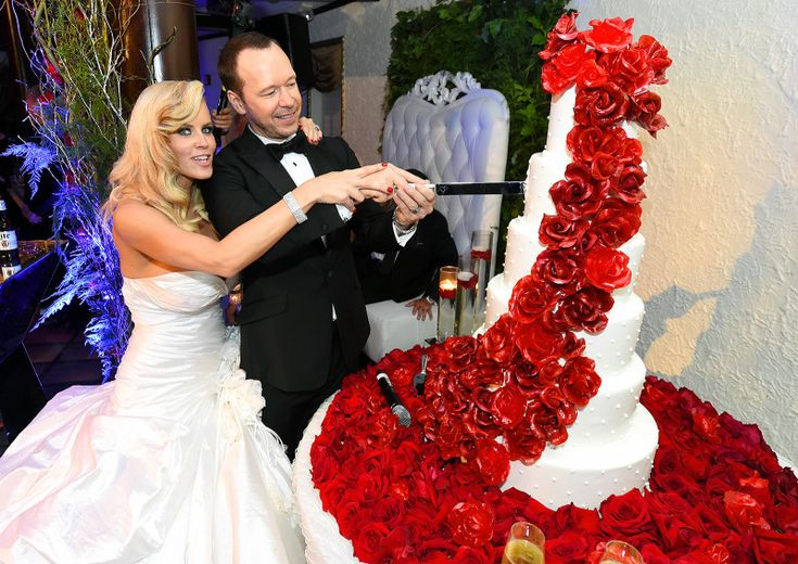 Newlyweds on the block! Jenny McCarthy and Donnie Wahlberg tied the knot in St. Charles, Illinois, outside Chicago on Aug. 31, 2014. Take a look at Us Weekly's exclusive photos of the couple's walk down the aisle, their kiss at the altar, their first slow dance as husband and wife, and more!