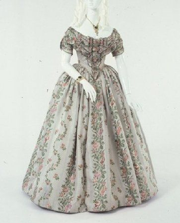 1840-1849. Two-piece light grey silk satin brocaded with red and mauve flowers in vertical vine pattern. (18th C. revival fabric).