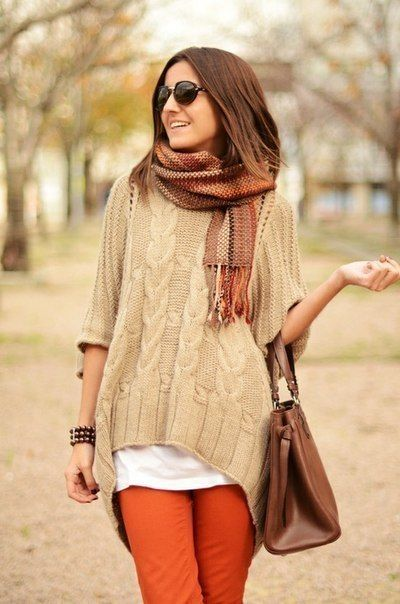 """""""Ha Ha, I am late again to pick up my Pumpkin Spice Latte"""" - says girl in photo (ok, i know i'm making fun of her expression and all, but i want the orange skinnies, oversized neutral cable knit, & fall hued scarf in my closet.  oh, and throw in the arm-bag, too, why don't you)."""