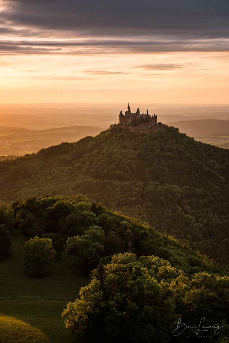 Golden Castle - Hohenzollern Castle - Burg Hohenzollern is the ancestral seat of the imperial House of Hohenzollern. The third of three castles on the site, it is located atop Berg Hohenzollern, a 234-metre (768 ft) bluff rising above the towns of Hechingen and Bisingen in the foothills of the Swabian Alps  of central Baden-Württemberg, Germany.