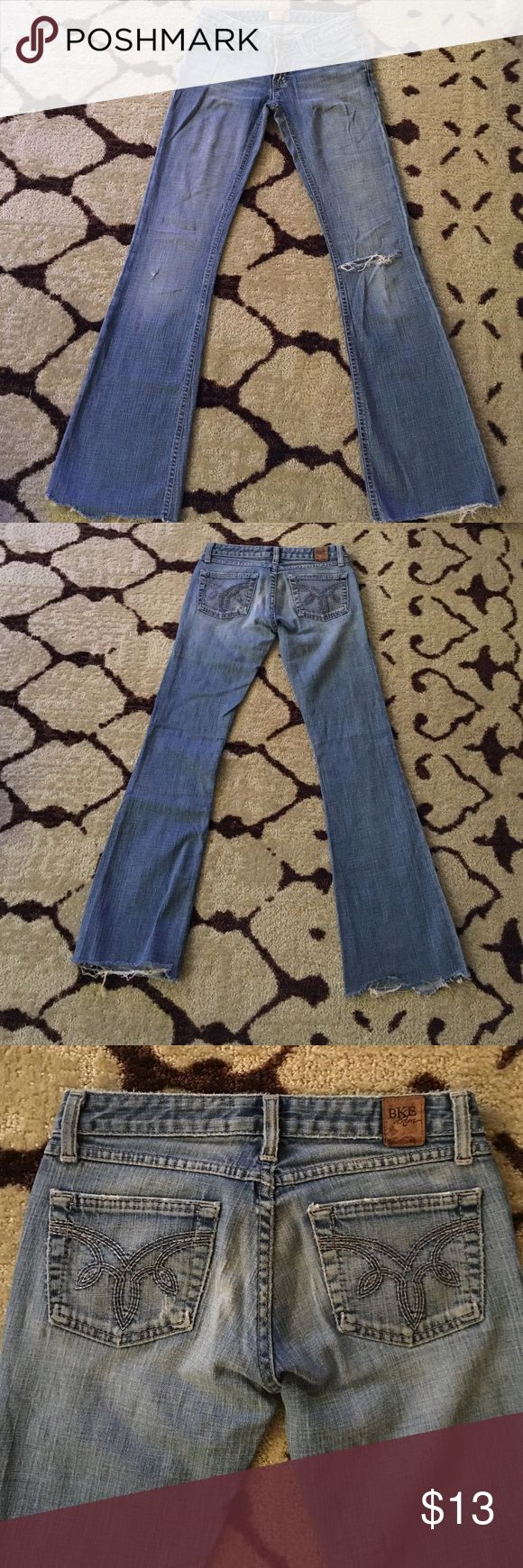 BKE stretch boot cut jeans size 25 BKE jeans size 25. Stretch boot cut low rise. Bottoms are cut to make the inseam 31 inches. The legs are frayed at the bottom one hole in the left knee and a tiny start of a hole on right side near knee. Denim is nicely worn and soft. BKE Jeans Boot Cut