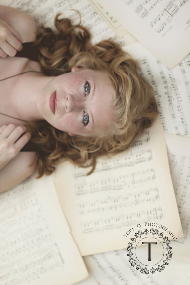 Senior pic idea!  :) with book pages and poems and drawings instead of music sheets