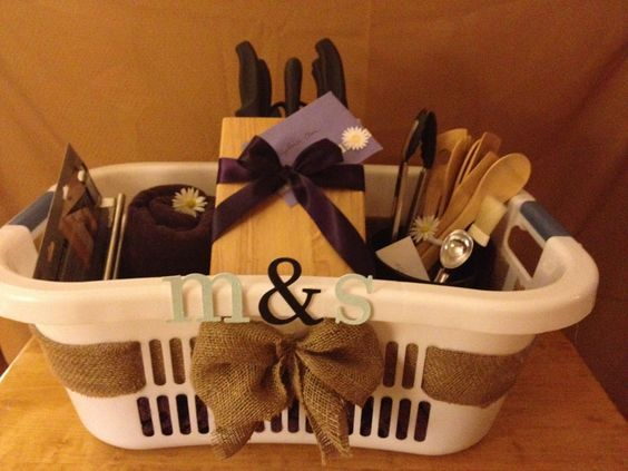For a beautiful and personalized wedding gift: order items from the bride & grooms registry and then decorate a laundry basket with their initials and burlap for lovely presentation!                                                                                                                                                      More: