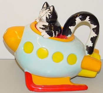 KLIBAN CAT IN SPACESHIP TEAPOT     (cartoons.osu.edu)