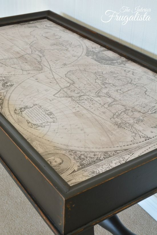 This table got a makeover with black paint and decoupaged with old world map wrapping paper.  So pretty!