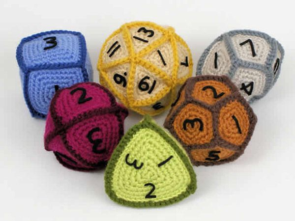 Crocheted polyhedral dice. For a moment I thought they were kippahs (yarmulkes). Which of course now makes me want a d20 kippah!