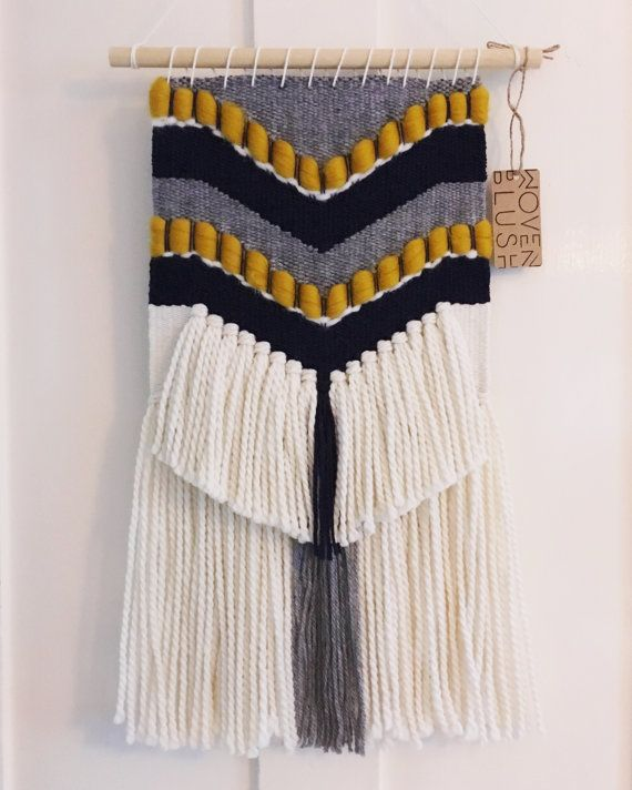 A handmade woven chevron-esqe wall hanging with off-white tassels hung on a 12* wooden dowel, this weaving hangs approximately 25* from the centre of the dowel to the bottom of the tassels, and measures 10.5* wide. Please message me with your preferences! Custom orders and made to order pieces will be finished and shipped within 2 weeks.  *Measurements are approximate.