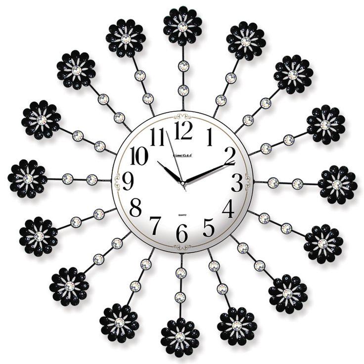 Taşlı Ferforje Çiçek Duvar Saati  Ürün Bilgisi ;  Ürün maddesi : Metal gövde, gerçek cam Ebat : 62 cm  Mekanizması : Akar saniye, sessiz çalışır Garanti : Saat motoru 5 yıl garantili Taşlı Ferforje Çiçek Duvar Saati Üretim  : Yerli üretim Kullanım ömrü uzundur Kalem pil ile çalışmakta Ürün fotoğrafta görüldüğü gibi olup orjinal paketindedir Sevdiklerinize hediye olarak gönderebilirsiniz