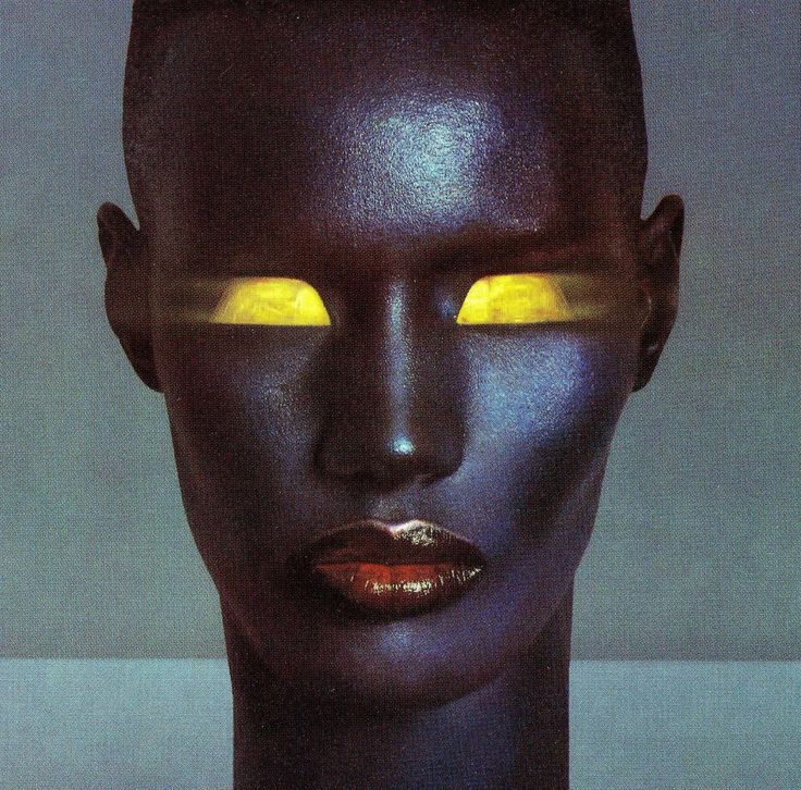 Light. Glowing- This picture shows her eyes as a bright yellow blur and creates the illusion of glowing eyes.  Slave to the rythem 1985 awesome till this day