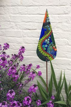 Glass garden mosaic - green blue & orange serpentine collection. This sculpture has been SOLD and has now moved to live in a Coventry garden! To order something similar for your garden, please contact me.