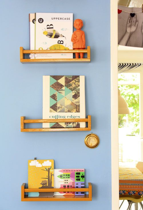 DIY bookshelves from IKEA spiceracks. Link to the actual spicerack: http://www.ikea.com/us/en/catalog/products/40070185/ $3.99 per, raw wood ready to finish