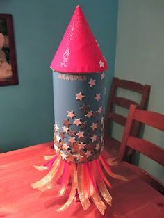 Rocket Ship Valentine box: my son & I made this for his Valentine school party!  It turned out adorable & was really fun to make. We used an oatmeal canister, tape, contruction paper & tissue paper. Fun project!!! Brook's advice :-)