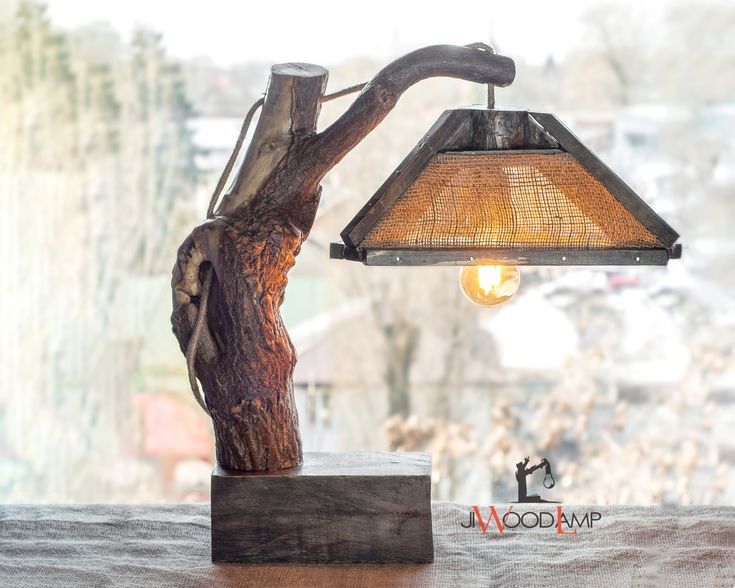 A wooden lamp with the burlap lamp shade