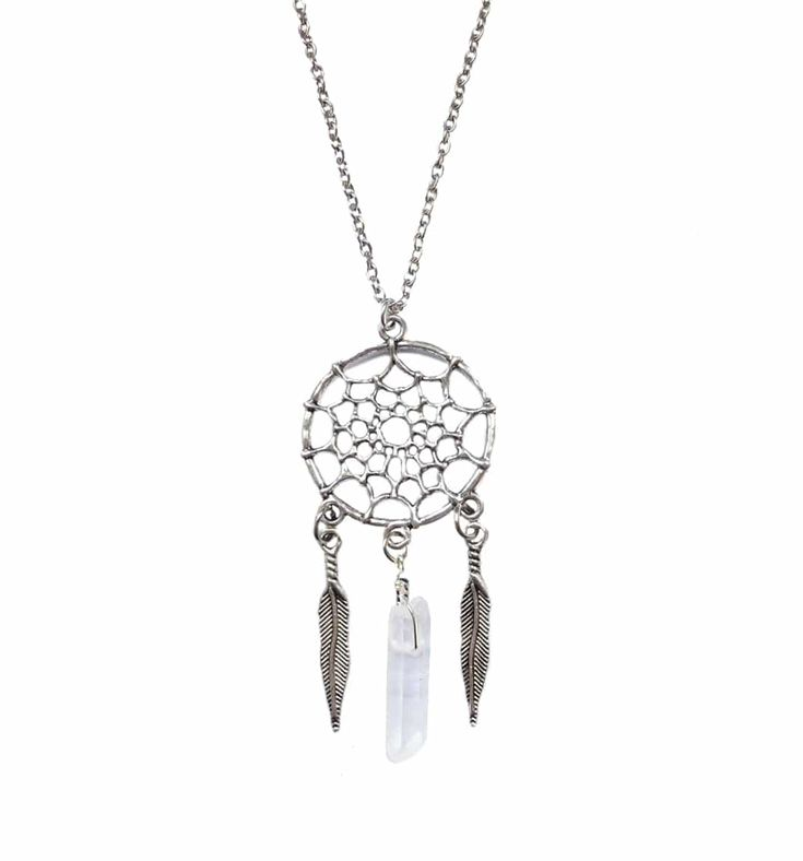 "Silver toned dream catcher necklace adorned with a beautiful raw clear quartz.  Clear Quartz is known as the ""master healer"" and will amplify energy and thought, as well as the effect of other crystals.  It is said to help to increase your energy, keeping your mind clear- to learn from past experiences so you can make better choices and to bring more balance, grace, and harmony to your life.     GOOD TO KNOW + Shipping EU about 3-5 working days. + Global shipping about 10-12 working..."