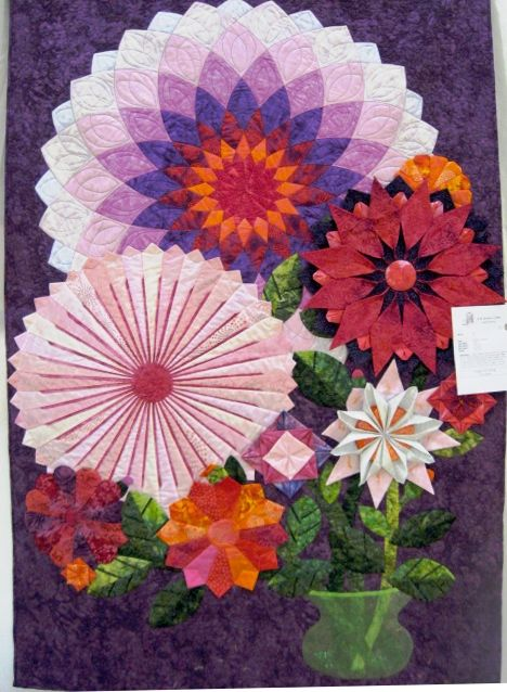Dahlias with Dresden plates; origami flowers. Photo by Nancy at Just Quilting posted at Flickr