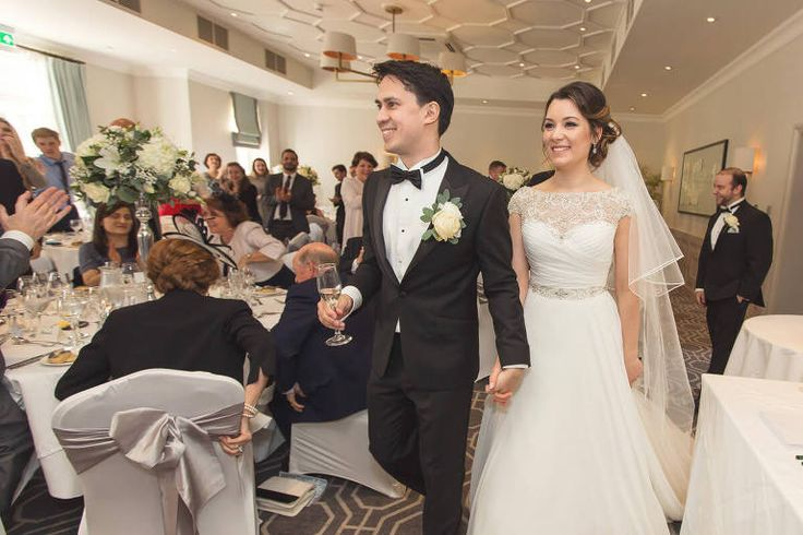 Wotton House Weddings | Bride and Groom entering the wedding breakfast