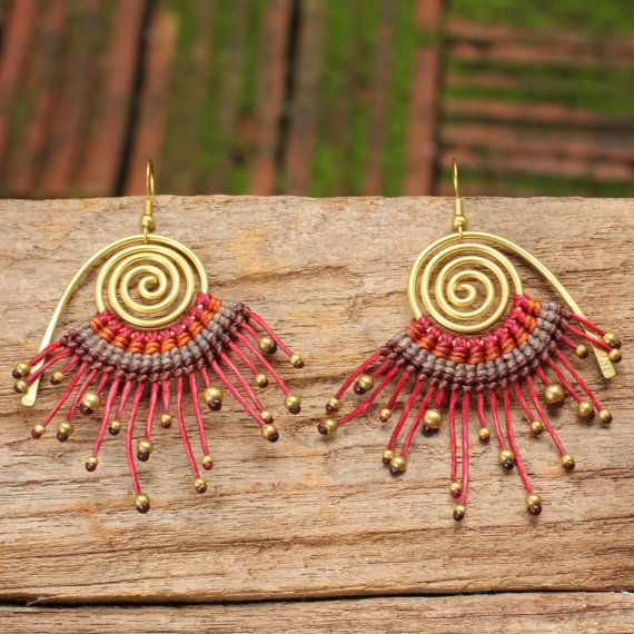 Brass spiral earring with woven cotton cord in red and orange tones