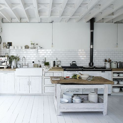 Like the white and wood interplayed with industrial elements.