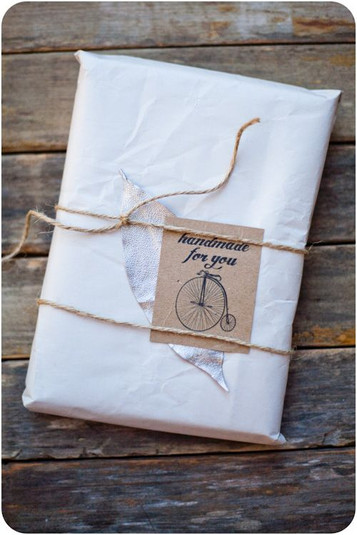 love this kind of gift wrapping...and conveniently i JUST bought this bicycle stamp two weeks ago!! it's fate:)