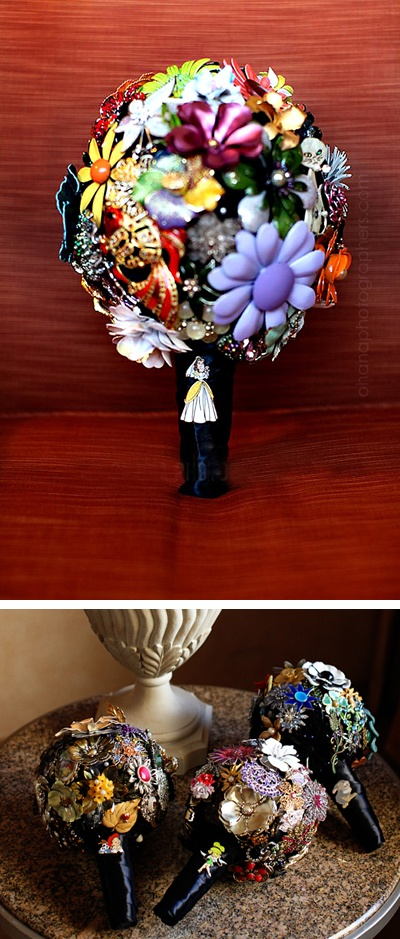 diy disney brooch bouquet.  bride attached a belle pin from beauty and the beast for her bouquet. she had different disney character pins for each bridesmaid that she felt best represented each girl. www.ohanablog.com