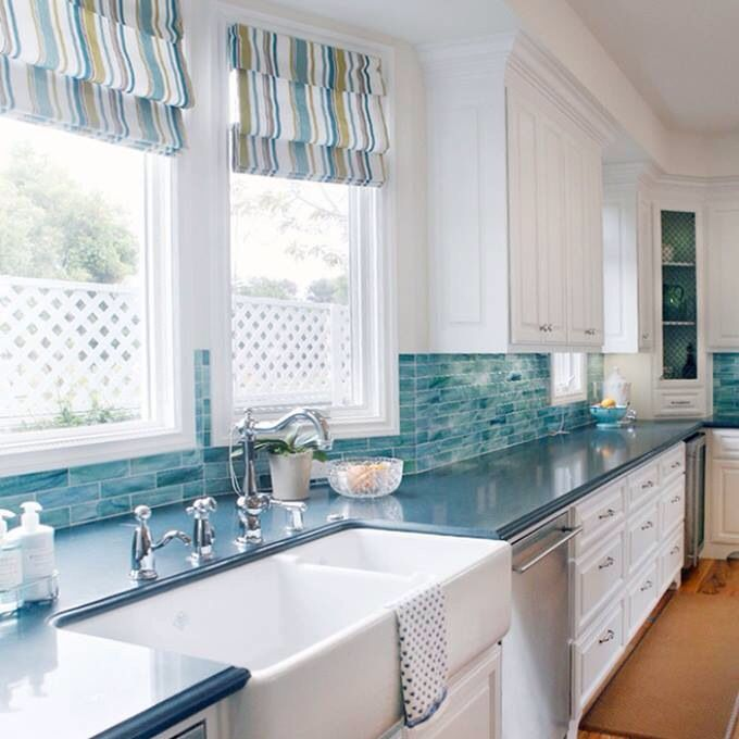 Coastal kitchen with turquoise backsplash.