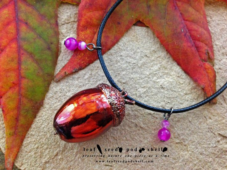 This real handpicked acorn is preserved in a bright copper electroformed coating, then given a pink patina veneer.  This particular piece also comes with four stunning striated agate cats eye beads. Available from www.leafseedpodshell.com #leafseedpodshell #leafseedpodshelljewelry #birdhouse #leaves #leaf #acorn #acorns #seeds #pods #shells #copper #electroform #electroforming #electroformed #electroplated #electroplating #crystal #crystals #rustic #plating #jewelry #jewellery #pendant…