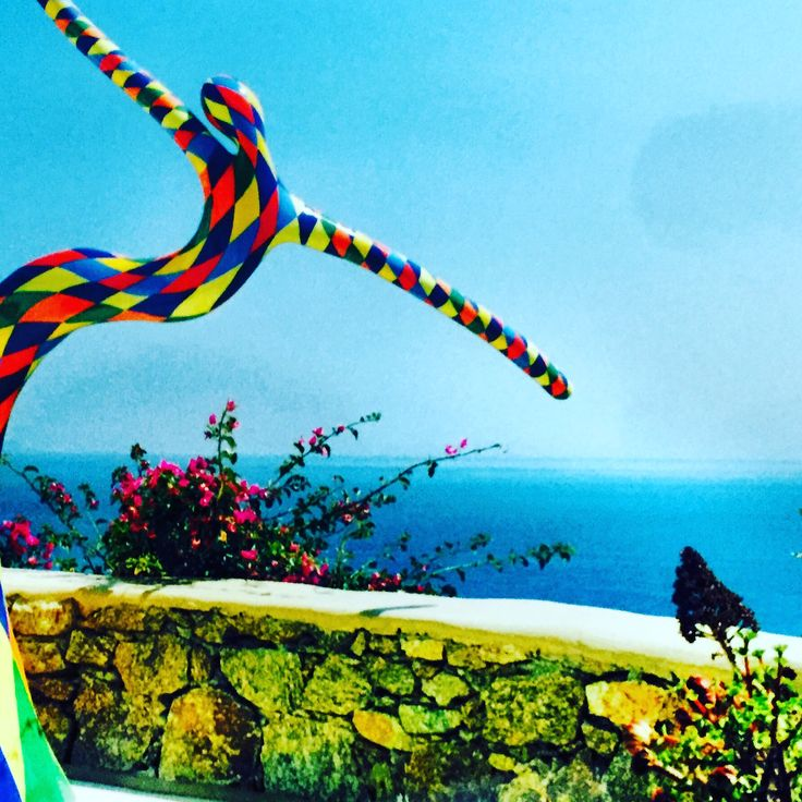 "Embracing the Aegean sea, sculpture artwork titled ""Harlequin"" by Vassiliki."