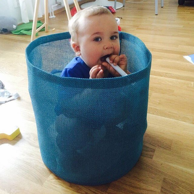 A baby boy in the Round Zone container.