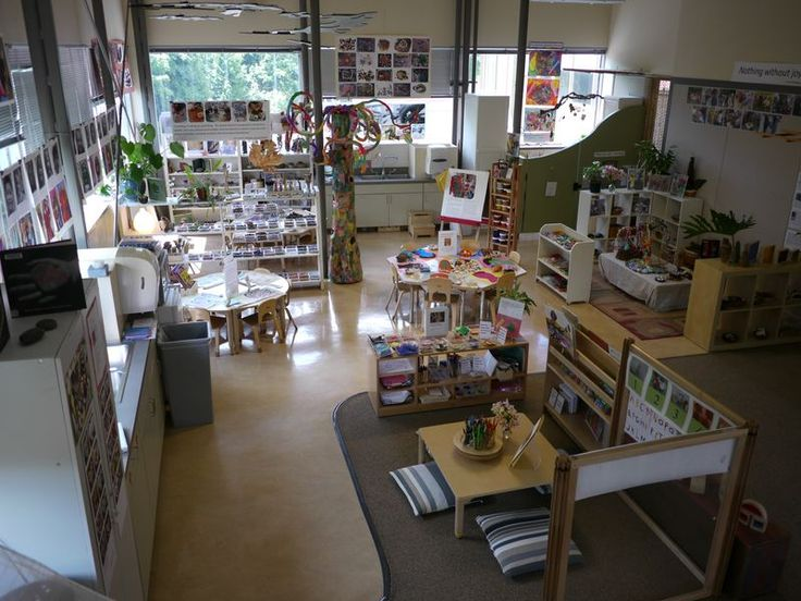 Opal School Preschool... Another great example of how to effectively organize a big open room into distinctive learning spaces to transform the space into a far calmer, cozier, and inviting environment.