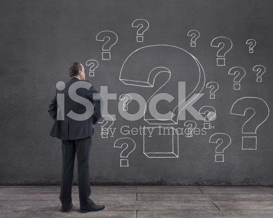 Businessman and Question Marks (royalty-free stock photo) © mgkaya
