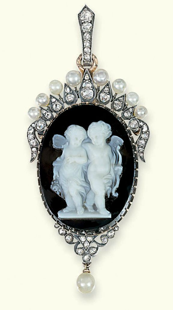 Antique banded agate, diamond and pearl cameo pendant.  The oval black and white agate cameo depicting Cupid and Psyche to the rose-cut diamond radiating surround with pearl finials, pendant drop and diamond-set suspension loop, mounted in silver and gold, pearls untested, circa 1880