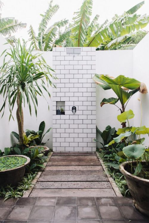 Outdoor shower with white subway tile