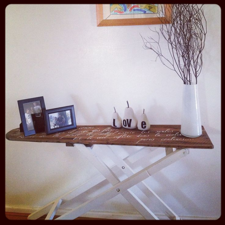 Converted ironing board hall table