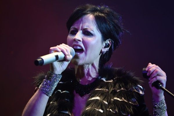 Dolores O'Riordan Photos - Irish singer Dolores O'Riordan of Irish band The Cranberries performs on stage during the 23th edition of the Cognac Blues Passion festival in Cognac on July 07, 2016. / AFP / GUILLAUME SOUVANT - Dolores O'Riordan Photos - 15 of 37
