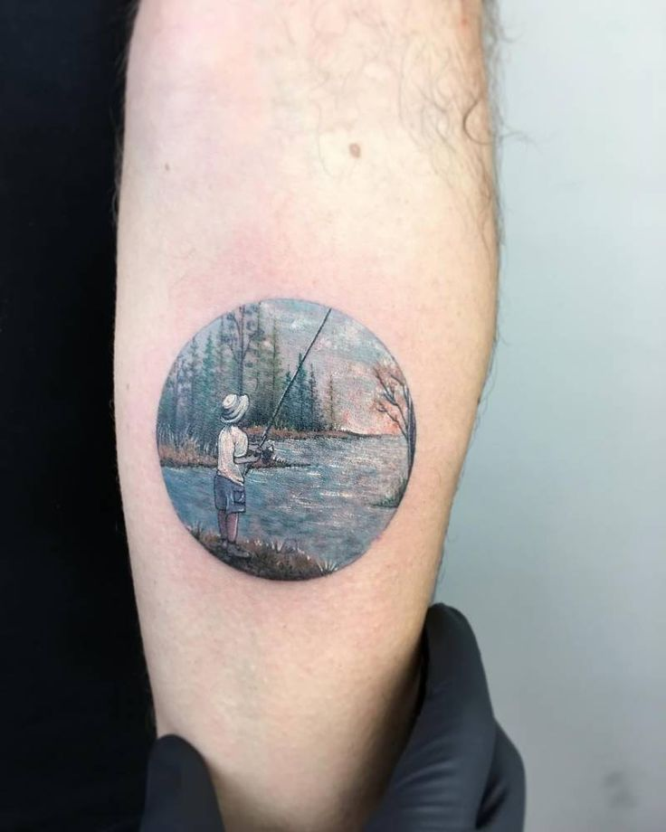 Young fisherman tattoo on the left inner forearm.