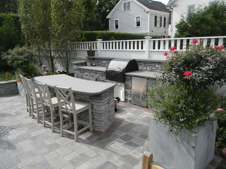 Outdoor Kitchen With Custom Bluestone Bar Top And Prep
