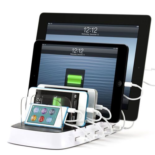 Charge your iPod, iPhone, and iPad with this awesome, super-organized power dock. Um....I need this now.