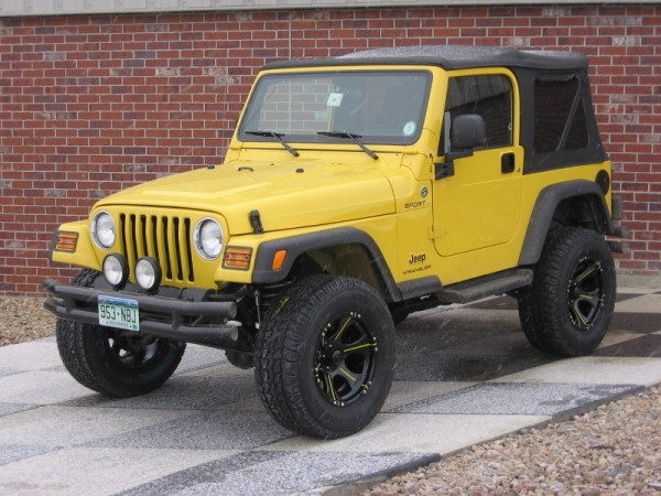 I've always wanted a yellow Jeep Wrangler. One of the older 90's models, not the newer ones.