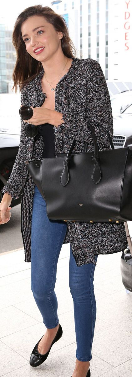 Miranda Kerr: Coat and shoes – Chanel  Sunglasses – Prada  Purse – Celine  Necklace – Swarovski