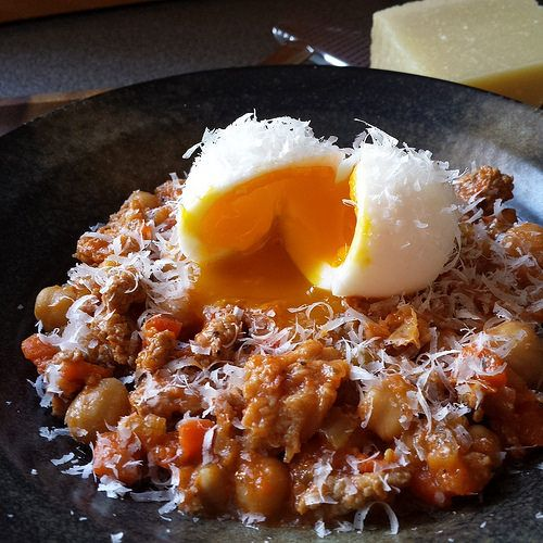 Trippa Alla Parmigiana, inspired by Porzia Toronto. Rustic stew of tripe, Italian sausage, chickpeas served with soft boiled egg.