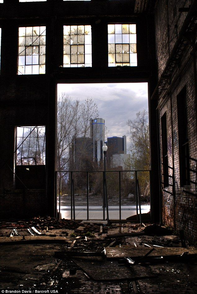 The abandoned Globe Trading Co. built in 1892 is pictured in Detroit, Michigan | The RenCen through the door for contrast.