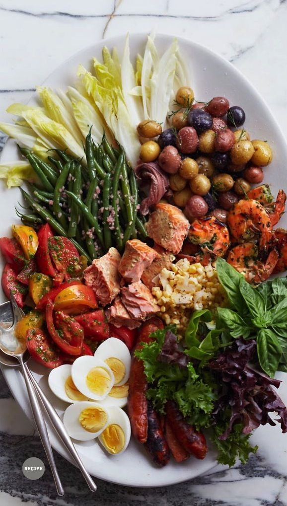 SALADE NIÇOISE ~ a specialty of Nice, on the French Riviera. A salade composée, arranged on the plate, consisting of Italian oil packed tuna, green beans, baby white potatoes, hard cooked egg, tomatoes, and Niçoise olives, on a bed of baby lettuce, dressed with local olive oil.