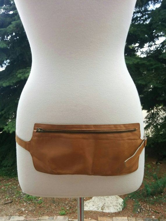 Check out this item in my Etsy shop https://www.etsy.com/listing/448975904/vintage-70s-tan-leather-single-pouch